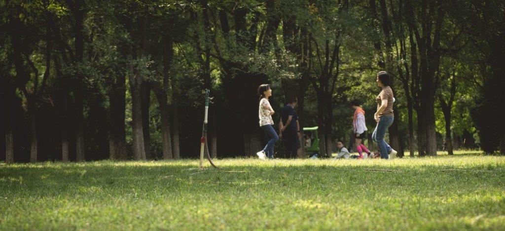 People enjoying parkland
