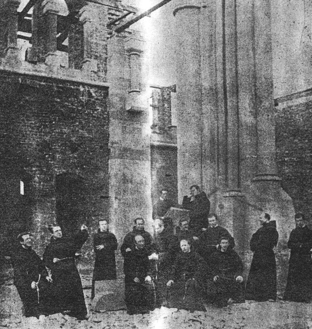 Friars looking at the construction of the church